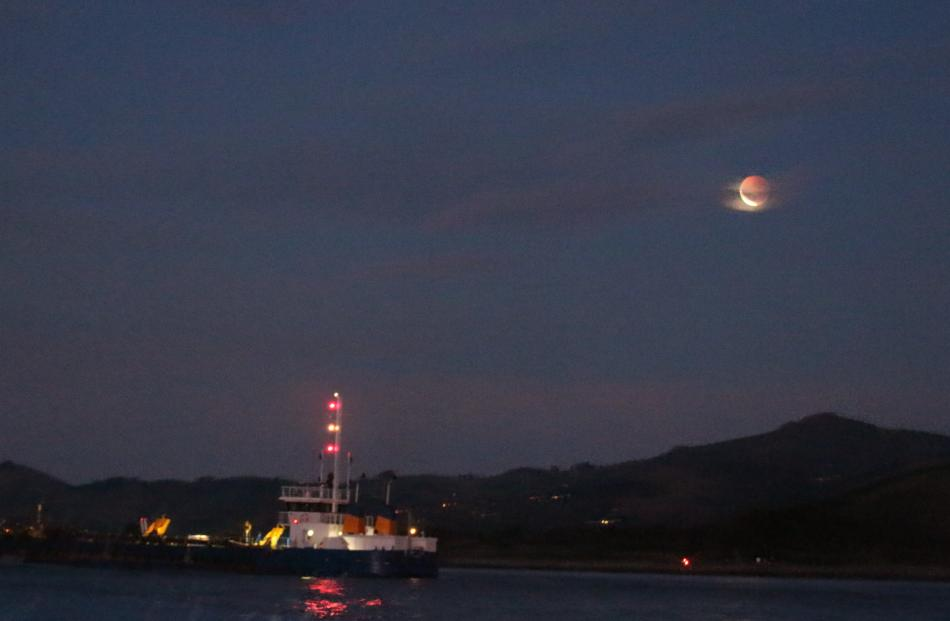 Eclipse seen from a boat heading out of Otago Harbour. Photo: Grant Godbaz