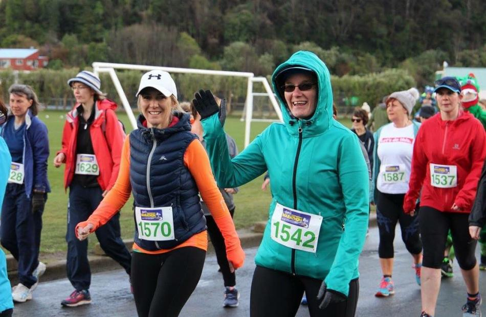 Half Marathon walkers, smiling at the start of the event.