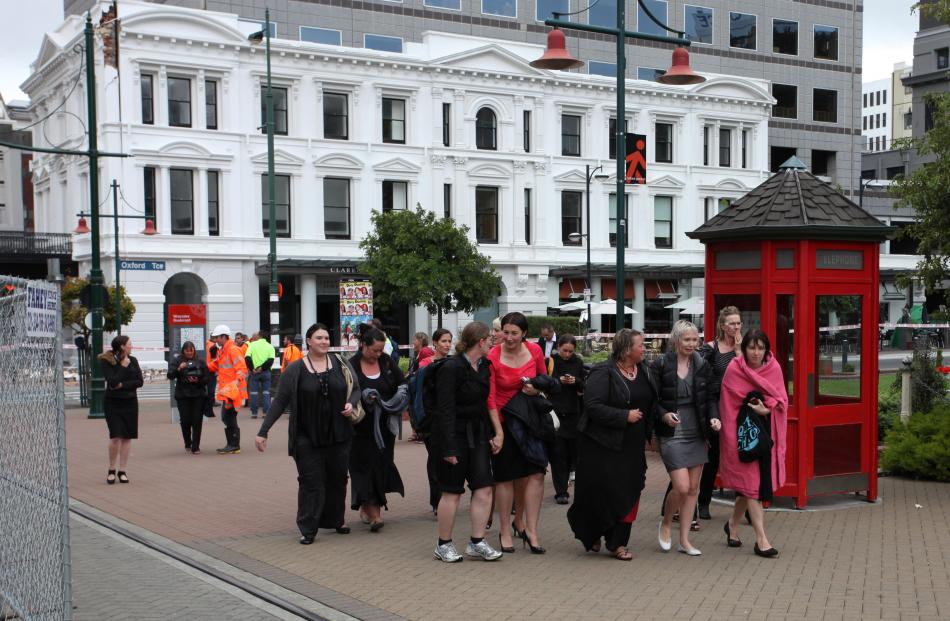 People evacuate the Clarenden Towers building. Photo by Pam Johnson/NZPA