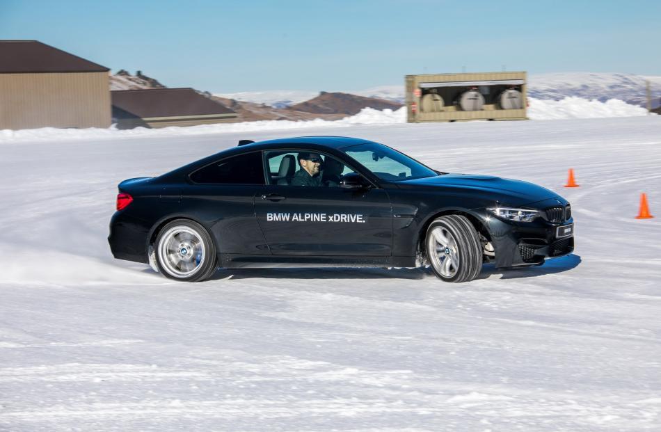 Author David Thomson drifting a BMW M4.
