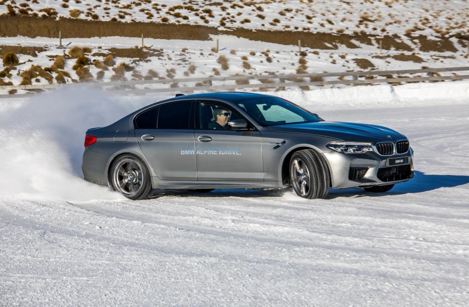 Who wouldn't smile drifting the mighty BMW M5 on snow.