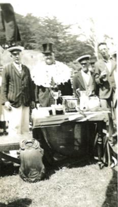 Prizegiving of trophies and silver cups. ''Commodore'' Herb Lanham (left) stands  next to the...