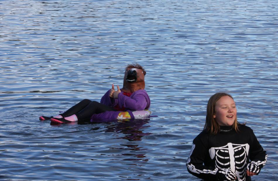 Lily Newcombe and Ruby Hefford take a second dip after the Polar Plunge.