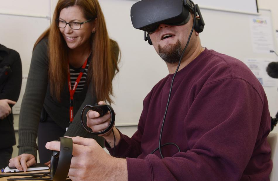 Animation Research chief executive Cheryl Adams shows an Otago Corrections Facility inmate the new virtual reality simulation, designed to teach automotive engineering skills. Photos: Gregor Richardson