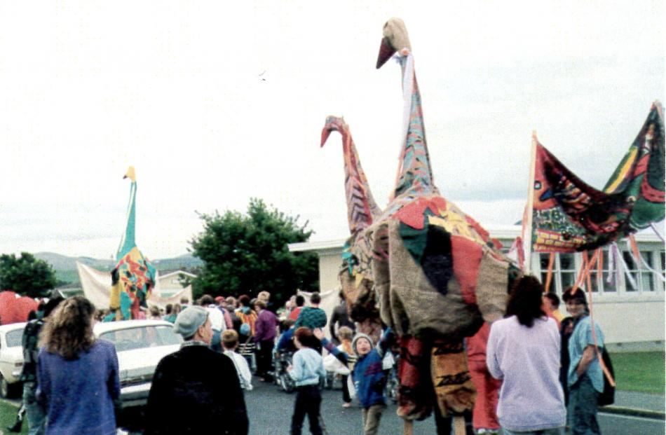 """Moa stilt-walkers parade with the taniwha to lay to rest """"the mythical beast of mental illness'' at Cherry Farm Hospital on November 5, 1987."""
