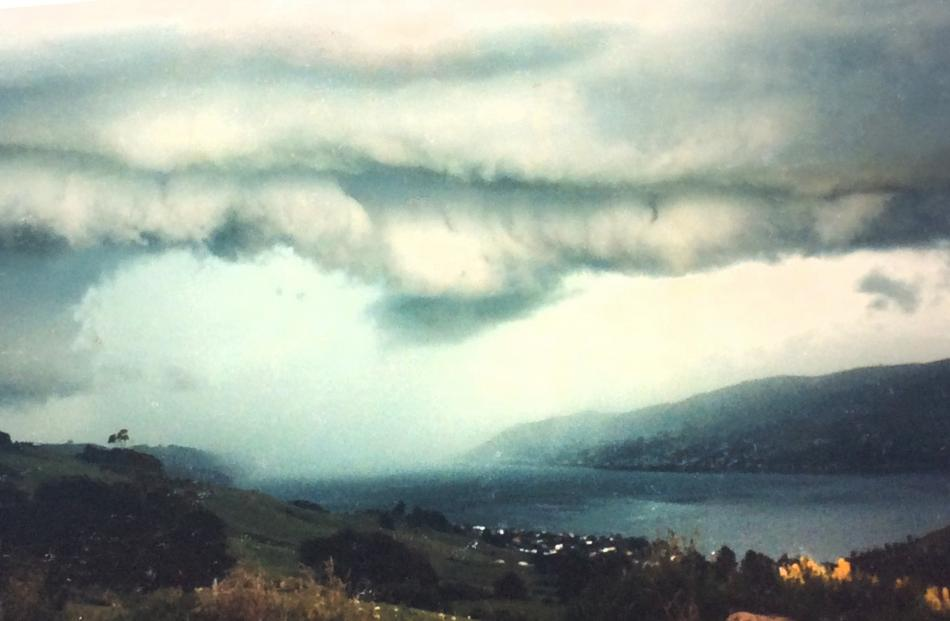 One of the most ferocious cold fronts I have seen, slamming into Dunedin and moving up the harbour in December 1985. Photo: Peter Hall