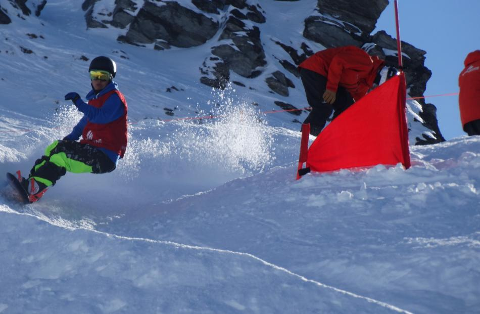 Chinese Paralympian Gengliang Liu (left) enjoys a good workout competing in the banked slalom...