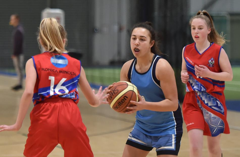 Sarah Kruishoop (centre, Queen's High School) looks to pass St Hilda's Collegiate defender Ria Dennison. Behind is Phoebe Parker (Queen's).