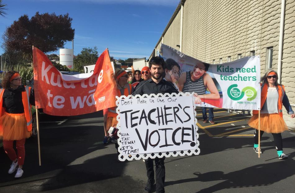 Dunedin teachers march outside the Edgar Centre today. Photo: Tim Miller