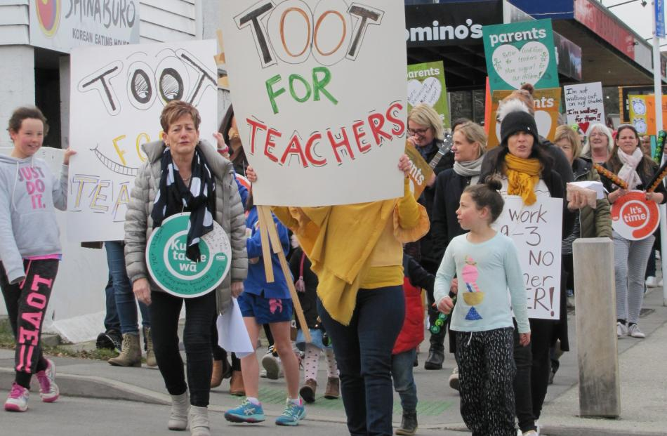About 150 adults and children, led by Wanaka Primary School principal Wendy Bamford, marched through the main street of Wanaka at 11.30am today in support of the primary teachers' strike.  Photo: Mark Price