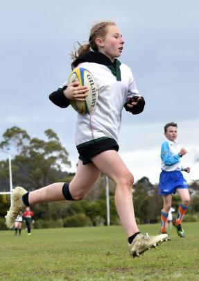 Rhianah Knopp-Jenkins (11), from Kaikorai Valley College, runs away to score at the Sassenachs intermediate rugby tournament at Bishopscourt yesterday. Photos: Peter McIntosh