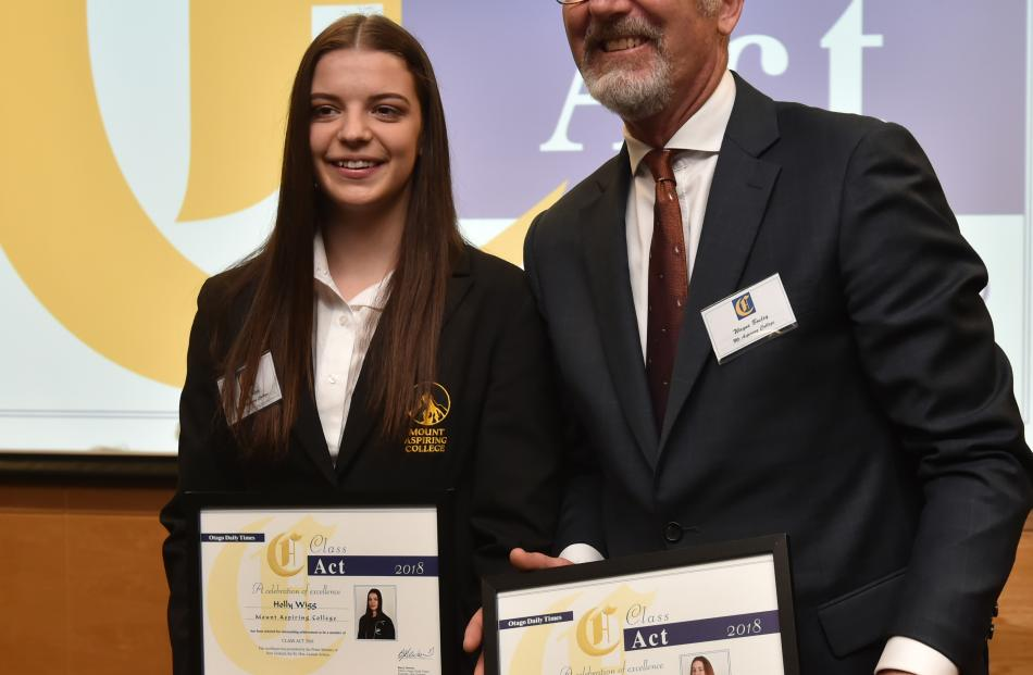 Mount Aspiring College pupil Holly Wigg (17) and principal Wayne Bosley, accepting on behalf of...