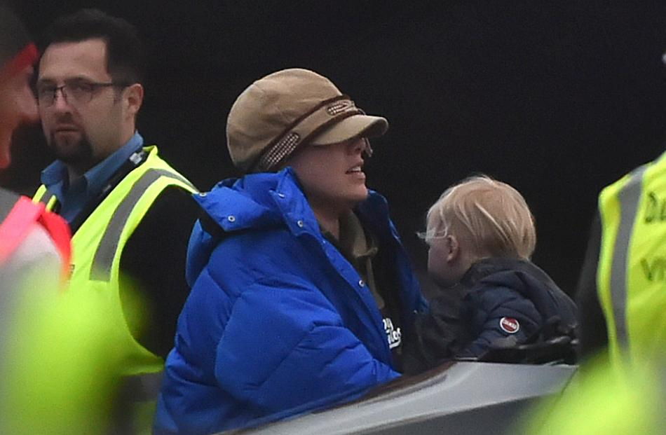 Pink and son Jameson wrap up warm after arriving on a private jet at a damp Dunedin Airport...