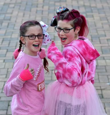 Hollie McDonnell (10, left) and Amelia Nicholson (11), both of Alexandra, are decked out in pink...