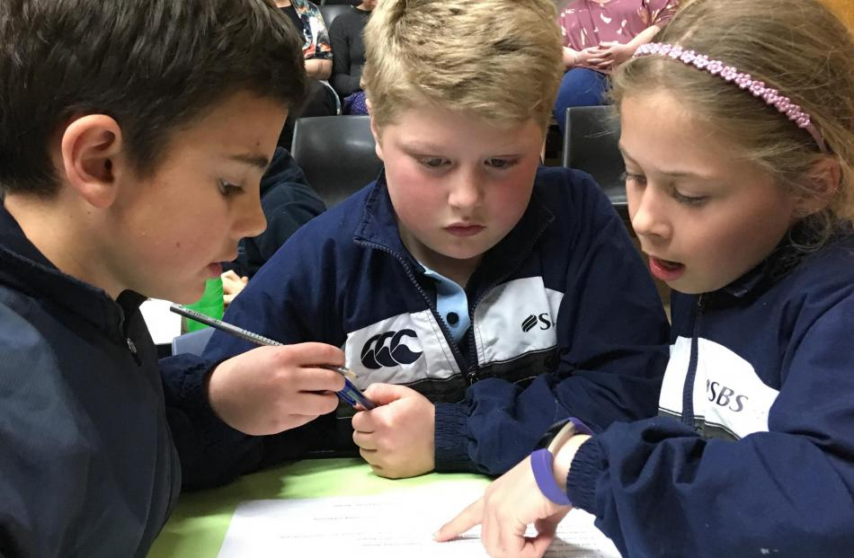 Maniototo Area School year 5 pupils (from left) Charlie Hore (9), Lachlan Mackenzie (9) and Vanessa Paterson (10) concentrate during the year 5-6 section.