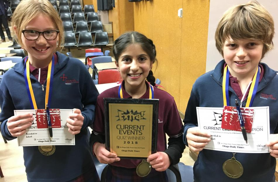 The winners of the year 5-6 Otago Daily Times Extra! current events quiz in Cromwell last night (from left), year 6 pupils Olivia Huddleston (11), Ania-Kanu Saklani (10) and Oscar Crowe (10), of Holy Family Catholic School, in Wanaka, celebrate their succ