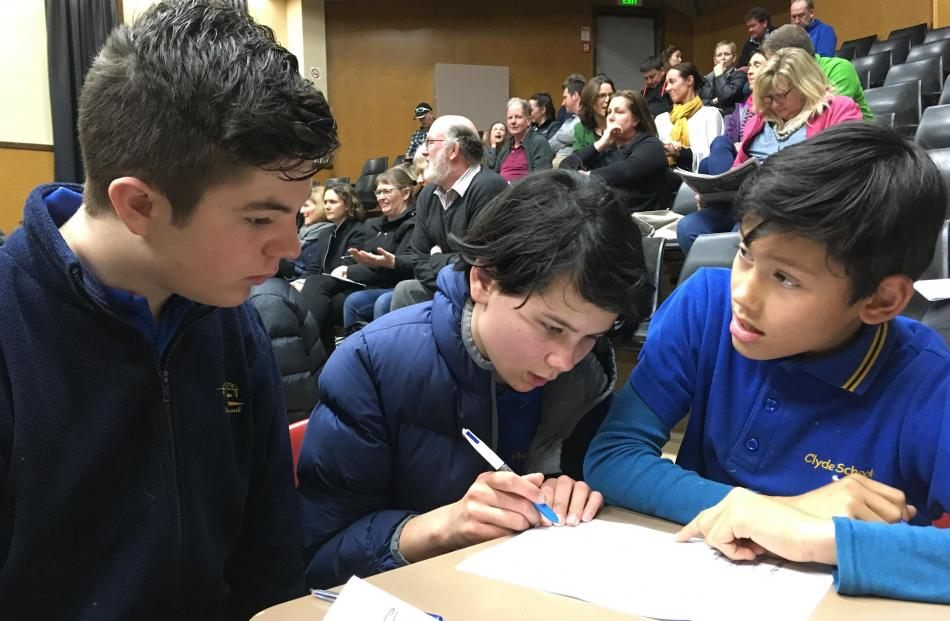 Clyde Primary School pupils (from left) Oscar Bartle (13, year 8), Jasmine Anderson (12, year 8) and Taine Morgan (11, year 7) confer during the year 7-8 quiz.