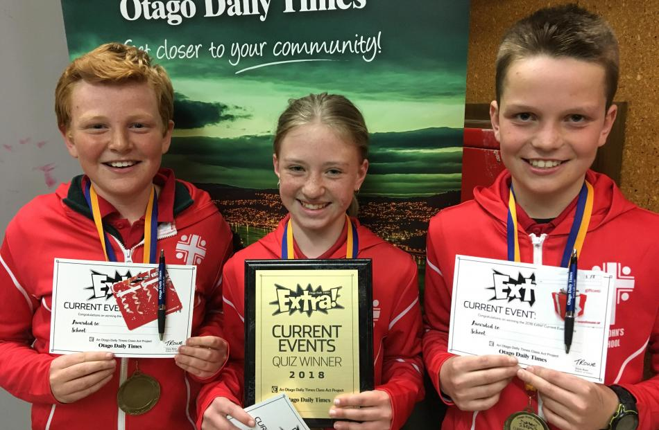 Winners of the year 7-8 Extra! current events quiz (from left) Freddie Hore (12), Maia Macdonald (12) and Jock Duncan (11), all in year 7, at St John's School, in Ranfurly, show off their certificates and medals.