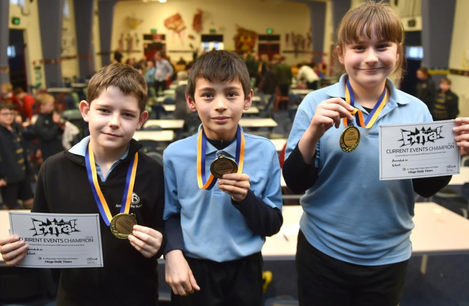 Anderson's Bay School pupils Oliver Grubb, Aidan Blakie and Tegen Baldwin celebrate their win in the Otago Daily Times Extra! Otago years 5 and 6 current events quiz yesterday.