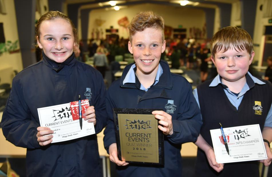 Taieri College pupils Emily Evans, Tom Cunningham and Caden Anderson show off the certificates they won in the years 7 and 8 current events quiz last night.