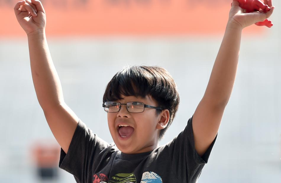 Luiz Lazaro (8), of North East Valley School, triumphantly holds aloft a rubber frog he  used to ...