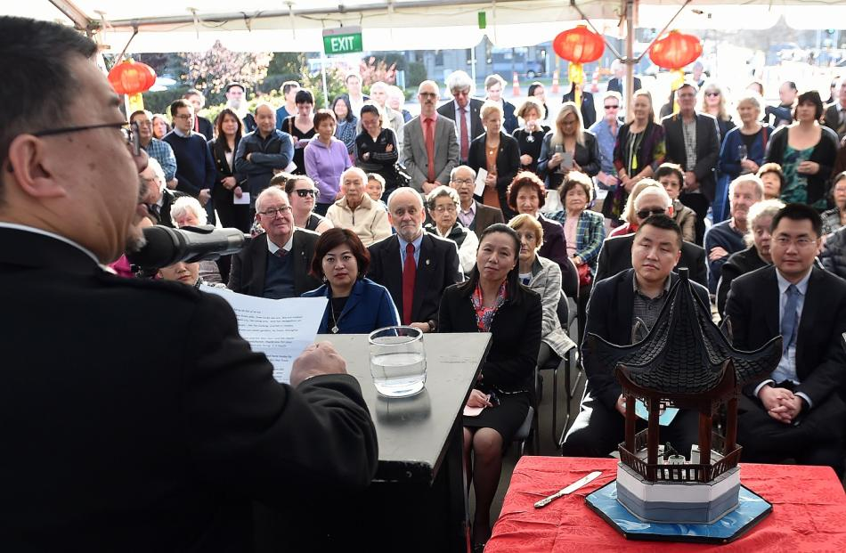 Dunedin Chinese Gardens Trust chairman Malcolm Wong addresses the crowd which gathered to mark...