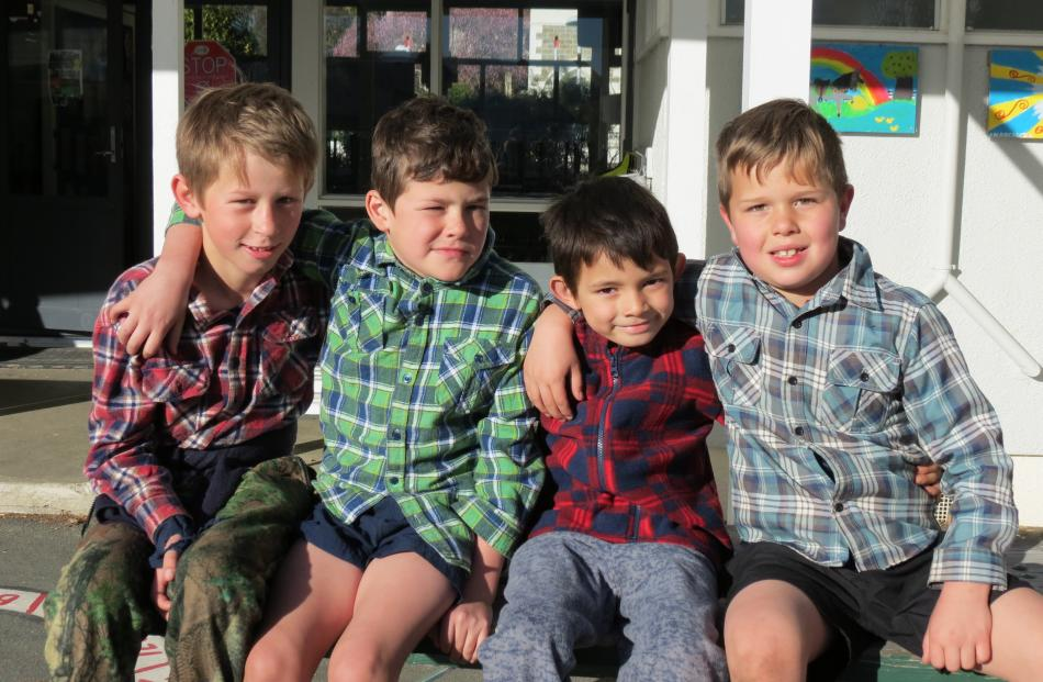 Ty McGregor (11), Regan Hill (9), Nathan Arneson (5), and Todd Abercrombie (7), all of Roxburgh Area School, at the tartan mufti day on Friday.