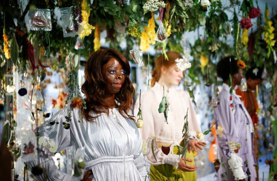 Models living with disfigurement present creations at the Steven Tai presentation at London...