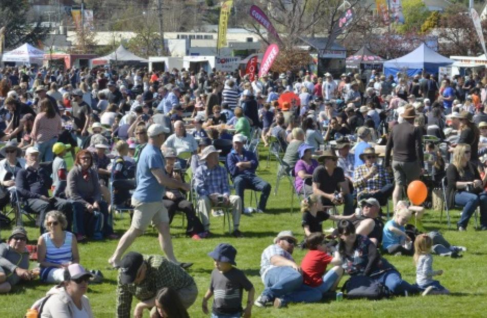 Festival-goers enjoy the Alexandra Blossom Festival entertainment at Pioneer Park on Saturday....