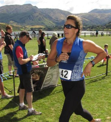 Anna Goodale, of Queenstown, completes her challenge, as race director Geoff Hunt logs her time....