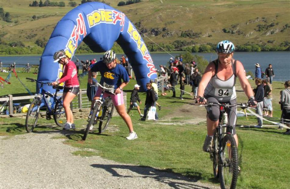 Corrina Paterson (No 94), of Invercargill, sets off on the cycling second leg of the duathlon,...
