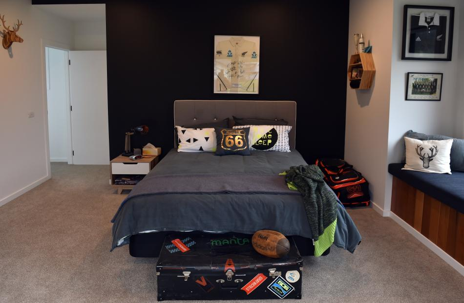 Sports-mad Liam (12) has a framed Black Caps jersey above his bed. His father's New Zealand under...