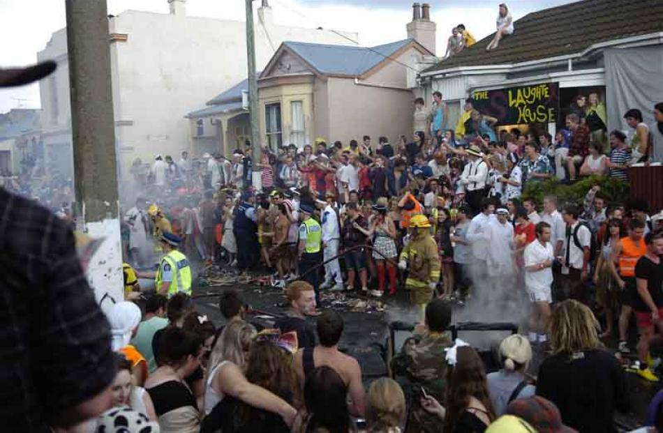 Later the party turns sour as a fire is doused. Photo by Jane Dawber.