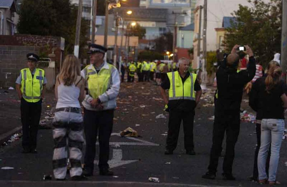 Police maintain cordons at each end. Photo by Jane Dawber.