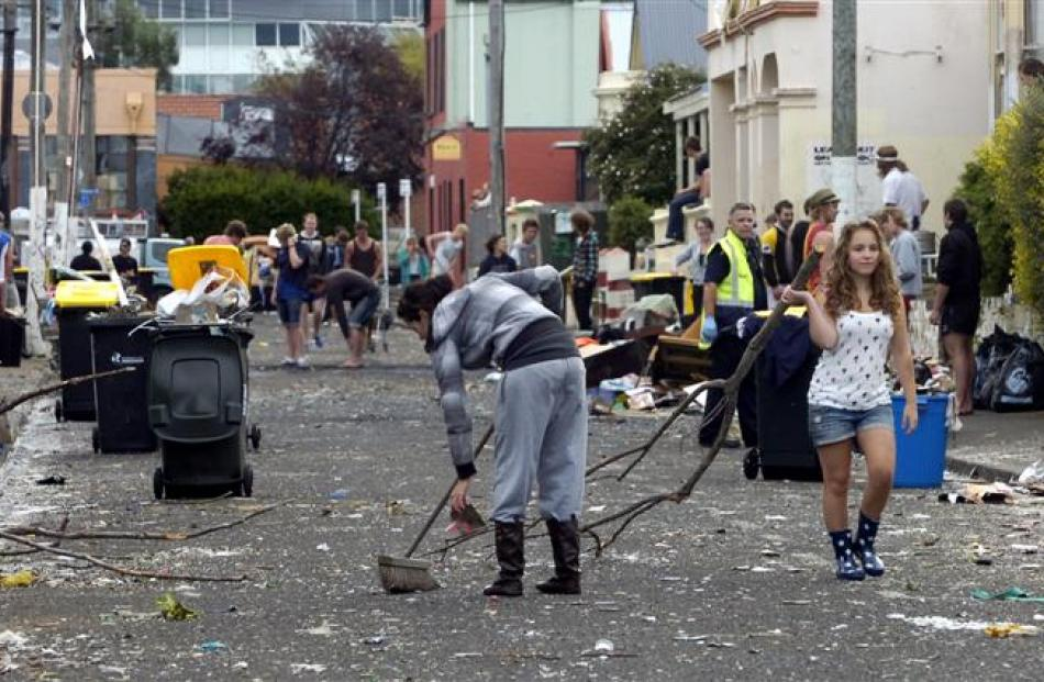 <b>10am:</b> Hyde St residents and helpers help clean up the mess yesterday.