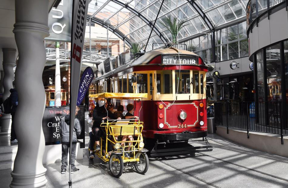 A tram and a tourist cycle in a squeeze at Cathedral Junction.