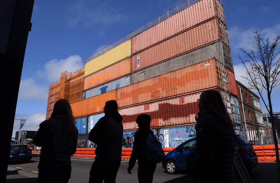 Stacked containers, like these ones in Hereford St, support damaged buildings.
