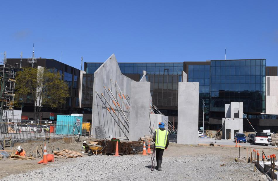 Concrete walls for a new central build go up across the road from the justice precinct. Opened in...