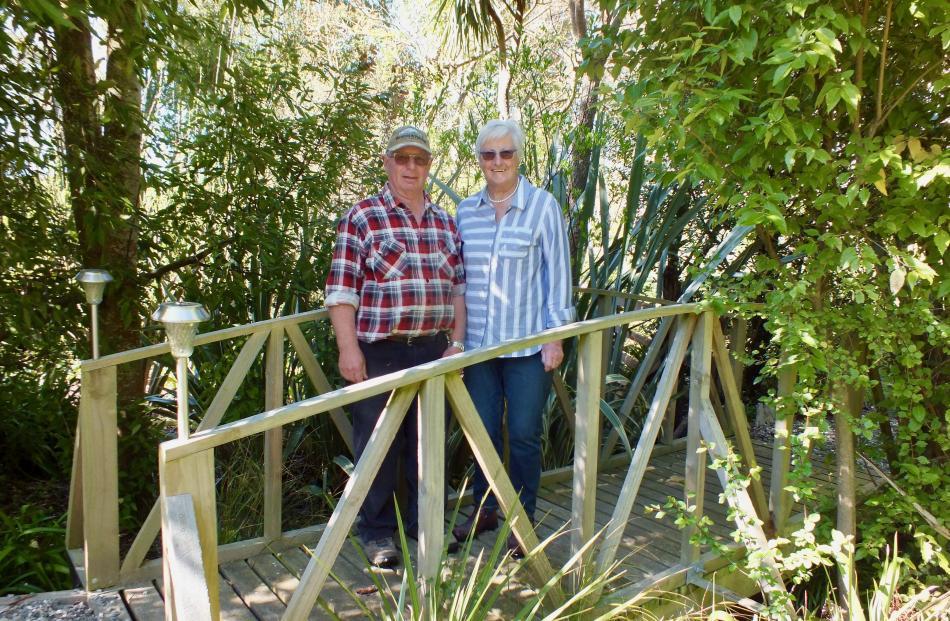 Margaret and Barry Sloper on the wooden bridge Barry built. Photos: Gillian Vine