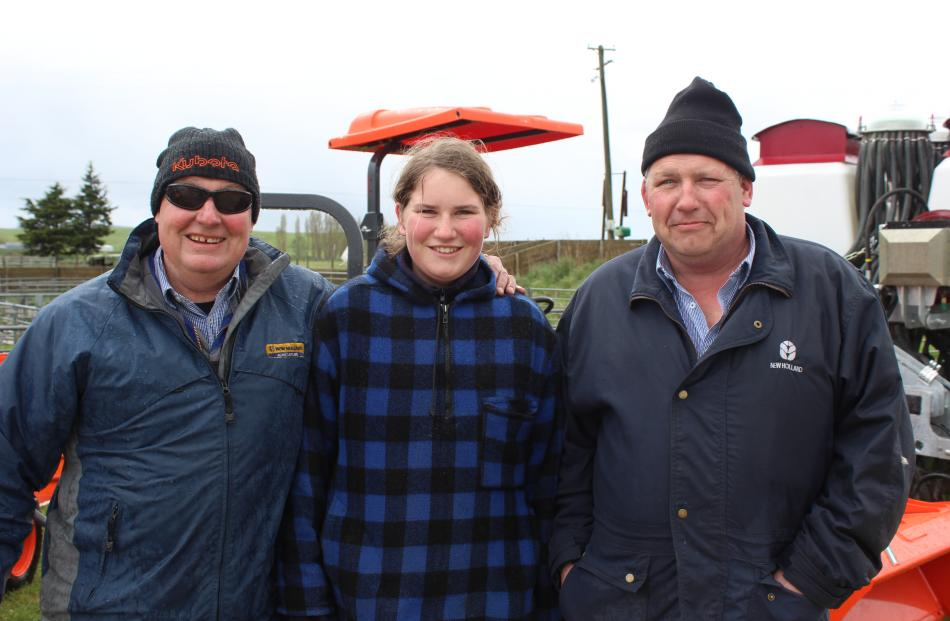 Staying warm are (from left) Graham Denize, of Oamaru, Ashley and Richard Robinson, of Dunback. Photos: Ella Stokes