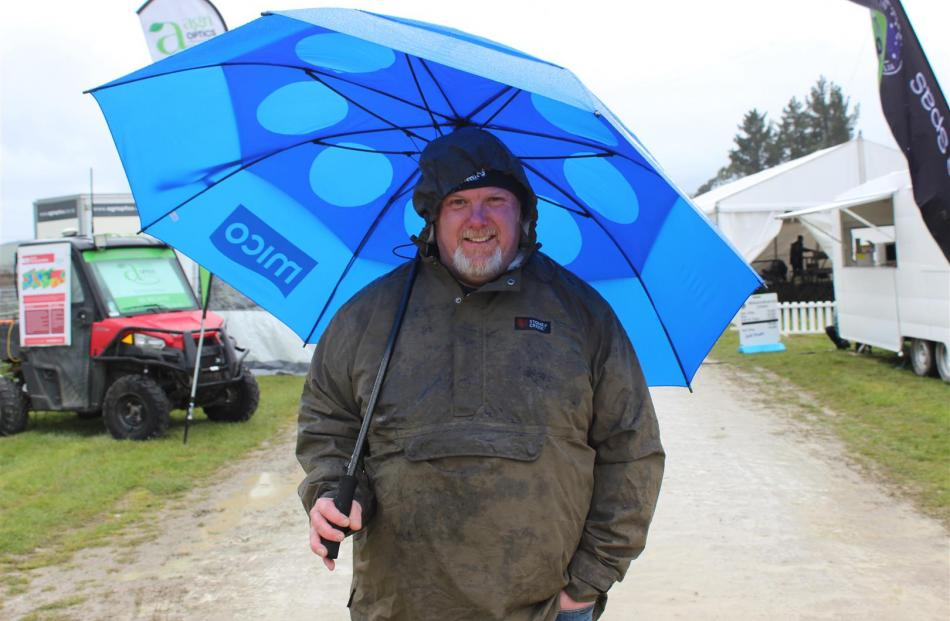 An umbrella was an essential for James Cleghorn, of Dunedin, at the Otago Field Days last Friday.
