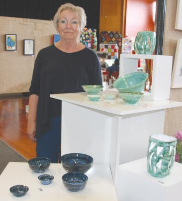 Jan Popham, Garage Potter of Te Anau, beside her work at the exhibition.Photo: Julie Walls
