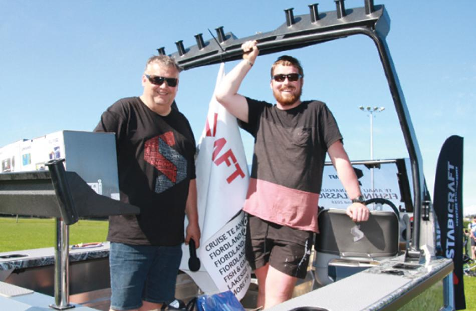Adam Lowe, Stabicraft Dealer Relationship Manager (at left) with the winner of the boat,...