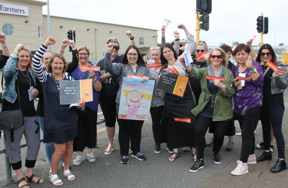 Teachers from Fernworth Primary and Donovan Primary schools rallying support on Leven Street...