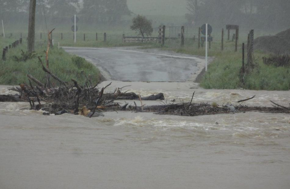 The Shag River in flood at Switchback Rd near Palmerston this afternoon. Photo: Bill Campbell