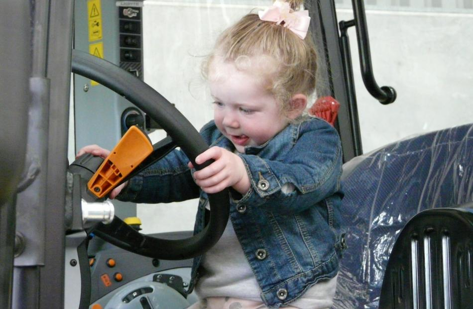Elliette Anderson (1), of Balclutha, takes the helm of the police tractor.