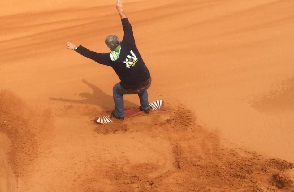 Peter Heron Sand boarding on the dunes. Photo: Deborah Heron