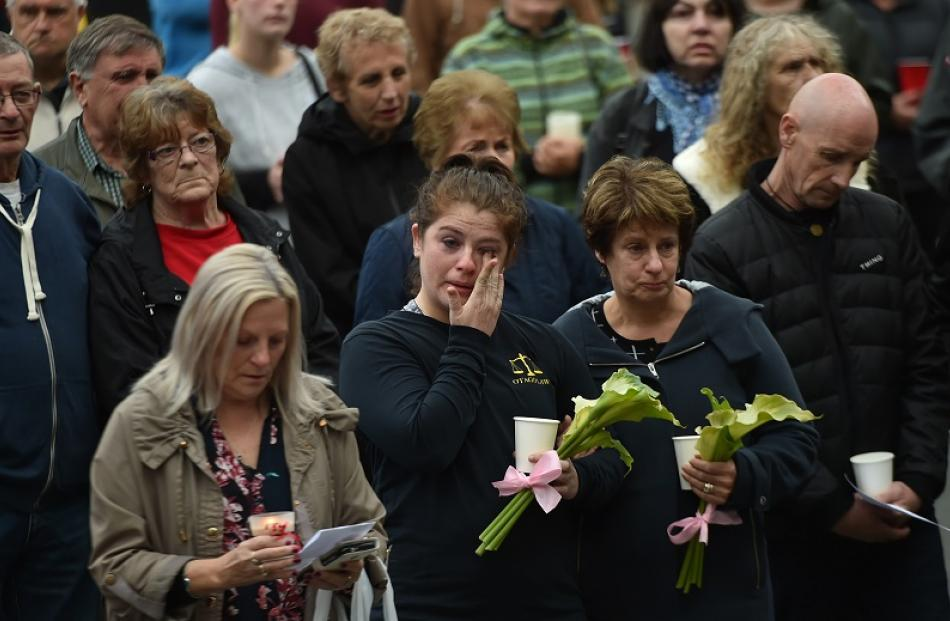 Tearful mourners attend the vigil.