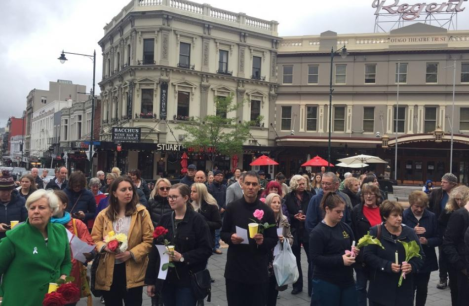 People gather in the Octagon in central Dunedin on Wednesday evening to remember slain English...