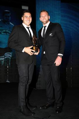 Brett Ranga (left) is presented with the award for Heartland Championship player of the year by...
